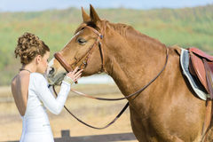 Fashion model kissing horse Stock Photos