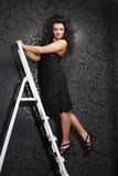 Fashion model on the ladder Stock Photo