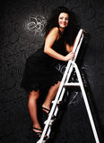 Fashion model on the ladder Stock Images