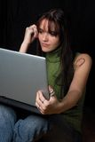 Fashion model - Laptop. Twenty something fashion working on laptop while sitting Royalty Free Stock Photos