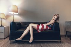 Fashion model laying down on sofa Stock Photo