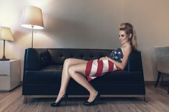 Fashion model laying down on sofa Royalty Free Stock Photography