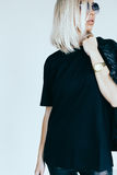 Fashion model in leather clothing and t-shirt Royalty Free Stock Photography