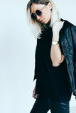 Fashion model in leather clothing and t-shirt Royalty Free Stock Images