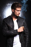 Fashion model in leather jacket smoking a big cigar Royalty Free Stock Photos