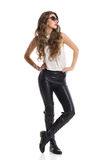 Fashion Model In Leather Pants Stock Image