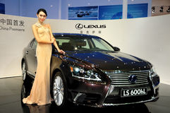 Fashion Model on LEXUS LS600hL saloon car Royalty Free Stock Photo