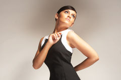 Fashion model on light background in black dress Royalty Free Stock Photos