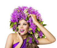 Fashion Model and Lilac Flowers, Beautiful Woman Hat, White Stock Image