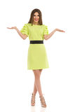 Fashion Model In Lime Green Dress Is Presenting With Hands Raised Royalty Free Stock Images
