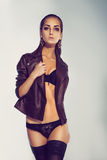 Fashion model in lingerie and leather jacket in studio Stock Photo