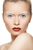Fashion model with lips make-up, creative eyebrows. High fashion image. Fashionable style of beautiful model with creative white eyebrows make-up and dark red royalty free stock photo