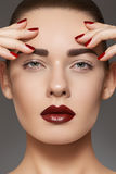 Fashion model with lips make-up, manicure on nails Stock Image