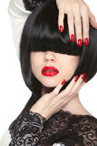 Fashion model. Long Black Fringe. Red sexy lips. Bob Hairstyle. Polish manicured nails. Haircut. Trendy woman portrait Stock Photography