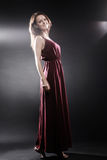 Fashion model in long dress Elegant woman Stock Photos