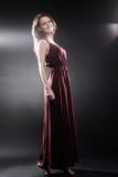 Fashion model in long dress Elegant woman Stock Photos