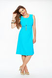 Fashion model with long hair dressed in blue dress Royalty Free Stock Photos