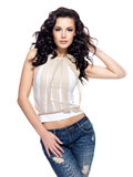 Fashion model with long hair dressed in blue jeans Stock Images