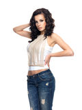 Fashion model with long hair dressed in blue jeans Stock Photos