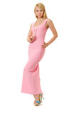 Fashion model in long pink dress. Stock Photos