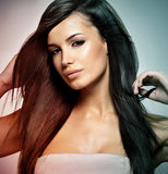 Fashion model with long straight hair. Royalty Free Stock Images