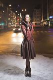Fashion model look outside on a city street Stock Image