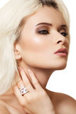 Fashion model with luxury make-up and chic jewelry royalty free stock photography