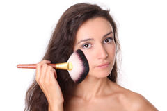 Fashion model with makeup brush Stock Image