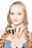 Fashion Model and Makeup Brushes Royalty Free Stock Photos