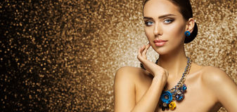 Fashion Model Makeup Portrait, Elegant Woman in Necklace Jewelry. Touching Face, Beautiful Slim Lady Make Up royalty free stock photos