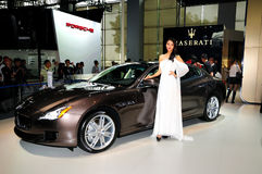 Fashion Model on Maserati Quattroporte Sports car Royalty Free Stock Photos
