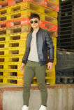 Fashion model, men, jacket, slim pants Royalty Free Stock Image