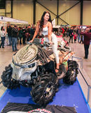 A fashion model at a motor show. Models on motorcycles presented at the motor show Royalty Free Stock Photos