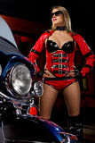 Fashion model with motorbike. Fashion model wears red clothes with motorbike Stock Photo