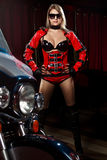 Fashion model with motorbike. Fashion model wears red clothes with motorbike Stock Image