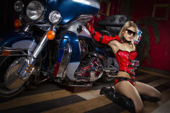 Fashion model with motorbike. Fashion model wears red clothes with motorbike Royalty Free Stock Photos