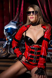 Fashion model with motorbike. Fashion model wears red clothes with motorbike Royalty Free Stock Images