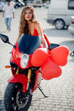 Fashion model on motorcycle royalty free stock images
