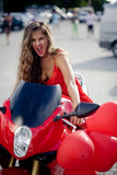 Fashion model on motorcycle Stock Images