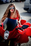 Fashion model on motorcycle Stock Photography