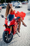 Fashion model on motorcycle royalty free stock photography