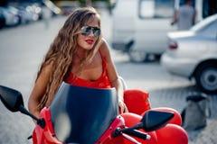 Fashion model on motorcycle royalty free stock image