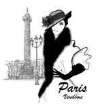 Fashion model nearby Vendome column in Paris Royalty Free Stock Photography