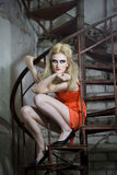 Fashion Model On The Spiral Stairs Royalty Free Stock Image
