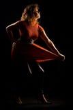 Fashion model in orange dress Royalty Free Stock Photo