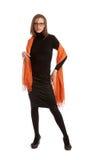 Fashion model with a orange scarf Stock Photos