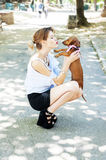 Fashion model in the park with a dog  Stock Photo