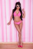 Fashion model in a pink bikini Royalty Free Stock Photography