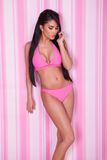 Fashion model in a pink bikini Royalty Free Stock Photo