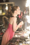 Fashion Model In Pink Slip Looking At Dressing Room Mirror Stock Photos